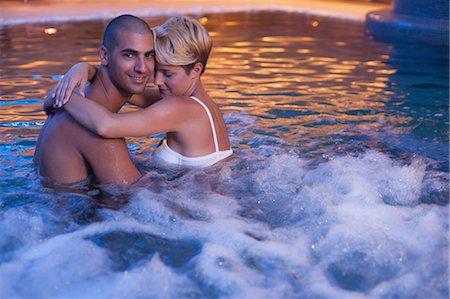 Couple relaxing in indoor jacuzzi Stock Photo - Premium Royalty-Free, Code: 649-06352502
