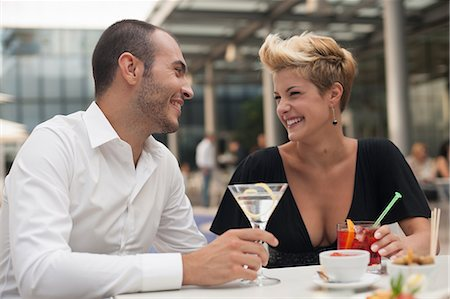 Smiling couple having drinks outdoors Stock Photo - Premium Royalty-Free, Code: 649-06352518