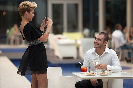 Woman taking picture of boyfriend Stock Photo - Premium Royalty-Free, Code: 649-06352519