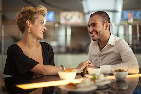 Smiling couple relaxing at bar Stock Photo - Premium Royalty-Free, Code: 649-06352511
