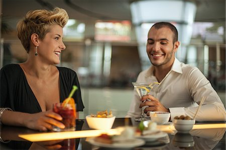 Couple having drinks at bar Stock Photo - Premium Royalty-Free, Code: 649-06352512