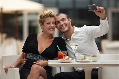 Couple taking picture of themselves Stock Photo - Premium Royalty-Free, Code: 649-06352520