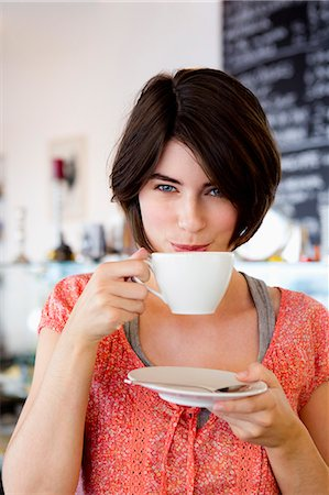 europe coffee shop - Smiling woman drinking coffee in cafe Stock Photo - Premium Royalty-Free, Code: 649-06352540