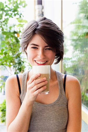 short hair - Smiling woman drinking coffee outdoors Stock Photo - Premium Royalty-Free, Code: 649-06352542