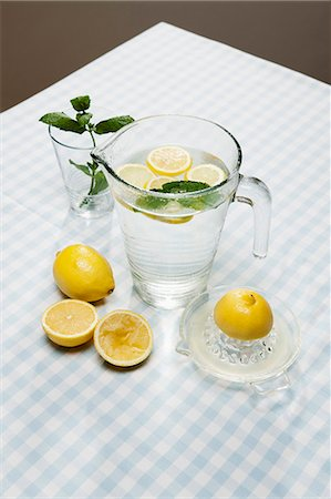 Lemons, herbs and pitcher of water Stock Photo - Premium Royalty-Free, Code: 649-06352613