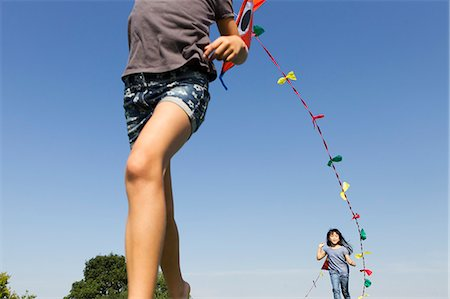 Children playing with kites outdoors Stock Photo - Premium Royalty-Free, Code: 649-06352627