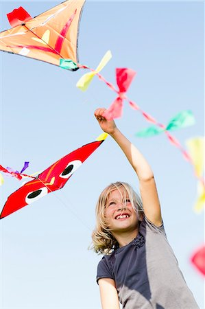 Girl playing with kite outdoors Stock Photo - Premium Royalty-Free, Code: 649-06352628