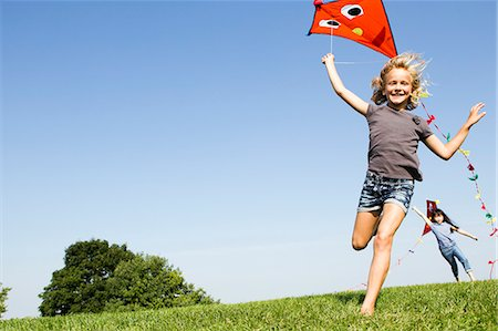 Girls playing with kites outdoors Stock Photo - Premium Royalty-Free, Code: 649-06352629