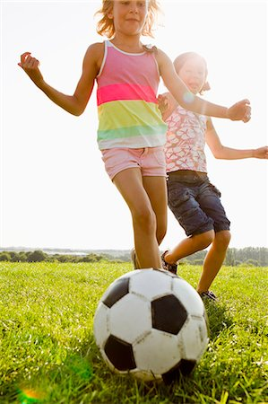 female playing soccer - Girls playing soccer in field Stock Photo - Premium Royalty-Free, Code: 649-06352636