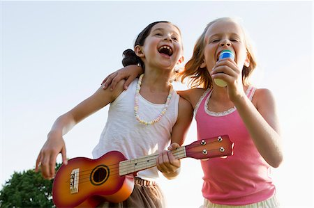 Girls singing together outdoors Stock Photo - Premium Royalty-Free, Code: 649-06352659