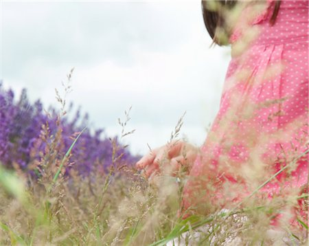 dreamy - Close up of girl in field of flowers Stock Photo - Premium Royalty-Free, Code: 649-06352676