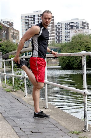 stretching (people exercising) - Runner stretching on city street Stock Photo - Premium Royalty-Free, Code: 649-06352717