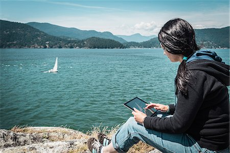 drawing computer - Woman using tablet computer outdoors Stock Photo - Premium Royalty-Free, Code: 649-06352777