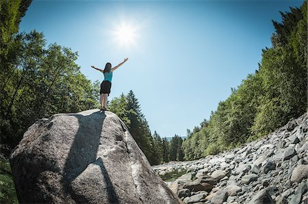 Woman with arms outstretched on rock Stock Photo - Premium Royalty-Free, Code: 649-06352770