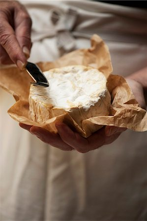 rustic - Close up of man slicing cheese Stock Photo - Premium Royalty-Free, Code: 649-06352853