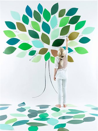 reaching - Girl painting tree on wall Stock Photo - Premium Royalty-Free, Code: 649-06352955