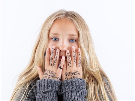 preteens fingering - Girl covering face with writing on hands Stock Photo - Premium Royalty-Free, Code: 649-06352968
