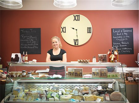 Grocer standing behind counter in shop Stock Photo - Premium Royalty-Free, Code: 649-06353036