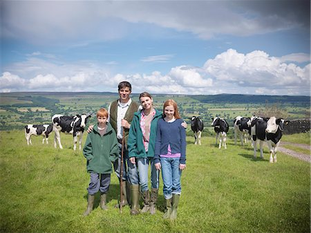 farm and boys - Farmer posing with family in field Stock Photo - Premium Royalty-Free, Code: 649-06353045