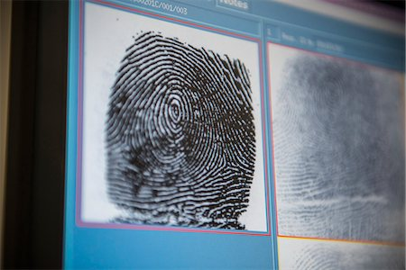 Fingerprints on screen in forensic lab Stock Photo - Premium Royalty-Free, Code: 649-06353094