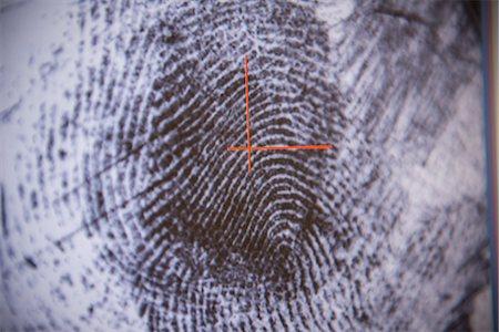 Fingerprint on screen in forensic lab Stock Photo - Premium Royalty-Free, Code: 649-06353096