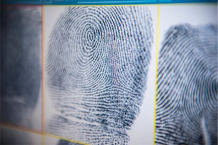 Fingerprints on screen in forensic lab Stock Photo - Premium Royalty-Free, Code: 649-06353093