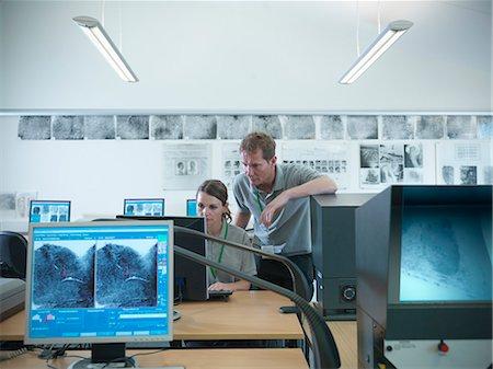 science & technology - Forensic students examining fingerprints Stock Photo - Premium Royalty-Free, Code: 649-06353122