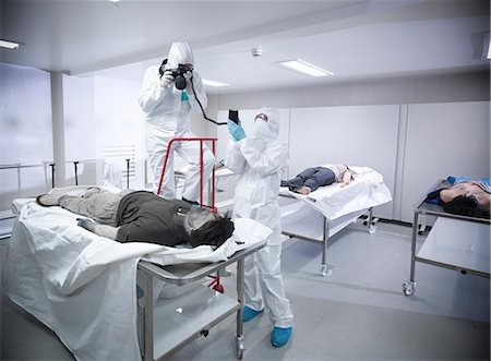 dead female body - Forensic scientists with false corpse Stock Photo - Premium Royalty-Free, Code: 649-06353165
