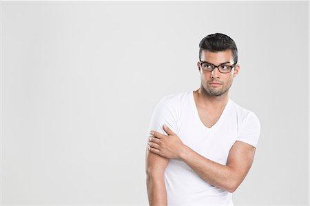 Curious man holding arm Stock Photo - Premium Royalty-Free, Code: 649-06353179