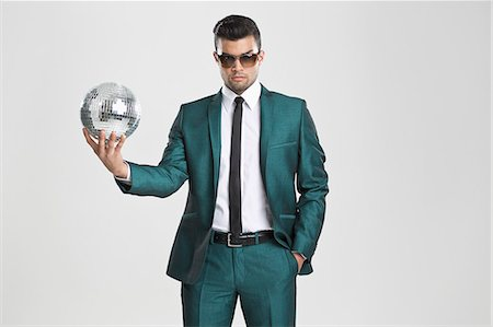 funky - Businessman holding disco ball Stock Photo - Premium Royalty-Free, Code: 649-06353192