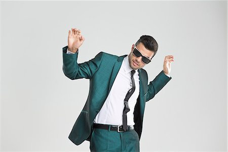 funky - Businessman in sunglasses dancing Stock Photo - Premium Royalty-Free, Code: 649-06353193
