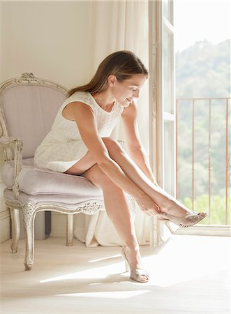 Woman putting on shoes Stock Photo - Premium Royalty-Free, Code: 649-06353225