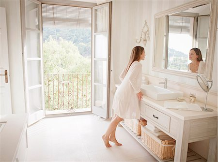 rich lifestyle - Woman admiring herself in mirror Stock Photo - Premium Royalty-Free, Code: 649-06353227