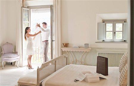 rich lifestyle - Couple admiring dress in window Stock Photo - Premium Royalty-Free, Code: 649-06353242
