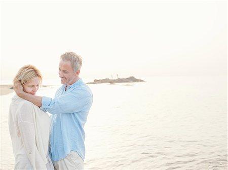 Older couple hugging on beach Stock Photo - Premium Royalty-Free, Code: 649-06353266