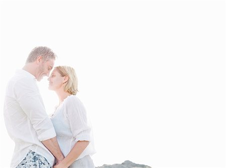 Smiling couple hugging outdoors Stock Photo - Premium Royalty-Free, Code: 649-06353278