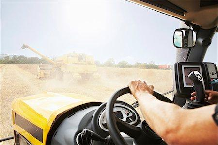 Farmer driving thresher in crop field Stock Photo - Premium Royalty-Free, Code: 649-06353294