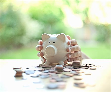reaching - Hands holding piggy bank Stock Photo - Premium Royalty-Free, Code: 649-06400385