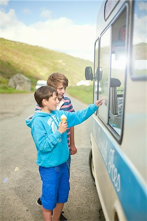 Boys buying ice cream from truck Stock Photo - Premium Royalty-Free, Code: 649-06400391