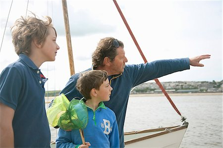 sailboat  ocean - Father and sons overlooking water Stock Photo - Premium Royalty-Free, Code: 649-06400406