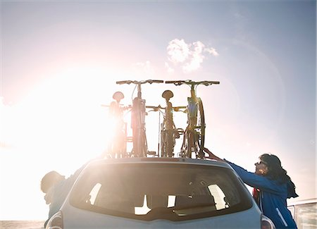 Mother and son tying bicycles on car Stock Photo - Premium Royalty-Free, Code: 649-06400400