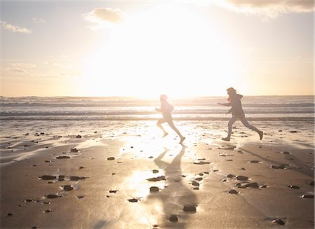 families playing on the beach - Mother and son running on beach Stock Photo - Premium Royalty-Free, Code: 649-06400401