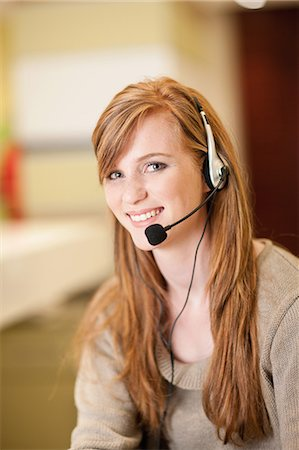 sale - Businesswoman wearing headset in office Stock Photo - Premium Royalty-Free, Code: 649-06400441