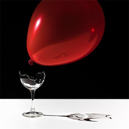 fragile - Balloon hovering over broken glass Stock Photo - Premium Royalty-Free, Code: 649-06400469