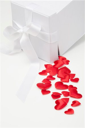 Satin hearts spilling from gift box Stock Photo - Premium Royalty-Free, Code: 649-06400700