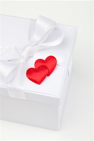 Satin hearts on gift box Stock Photo - Premium Royalty-Free, Code: 649-06400701