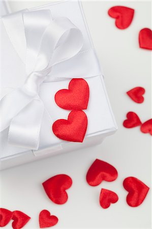 Satin hearts on gift box Stock Photo - Premium Royalty-Free, Code: 649-06400702