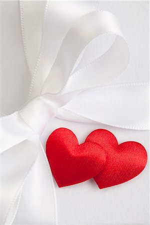 Satin hearts on gift box Stock Photo - Premium Royalty-Free, Code: 649-06400703