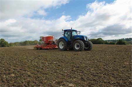 plow - Tractor working in crop field Stock Photo - Premium Royalty-Free, Code: 649-06400725