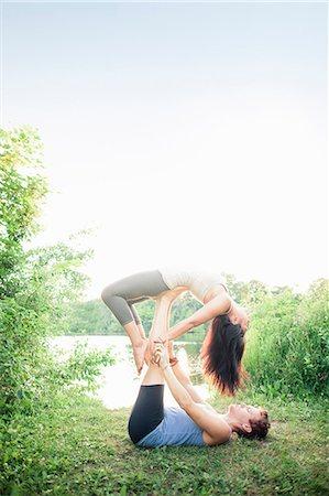 partnership - Couple practicing yoga in garden Stock Photo - Premium Royalty-Free, Code: 649-06400736